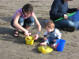 Finley and Samantha Building a Sandcastle