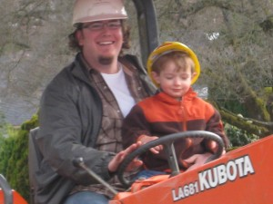 Finley with Uncle Nick on the Tractor