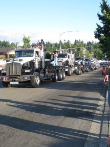 The long line of tow trucks.