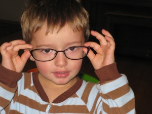 Finley wearing mommy's glasses