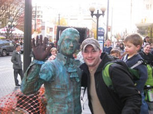 Tyler with the street performer.