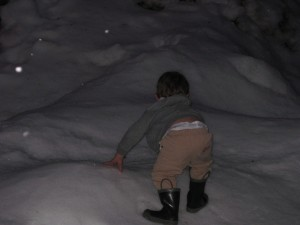 Finley climbing a hill of snow at the summit