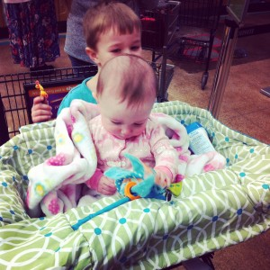 Big Girl in the shopping cart for the first time.